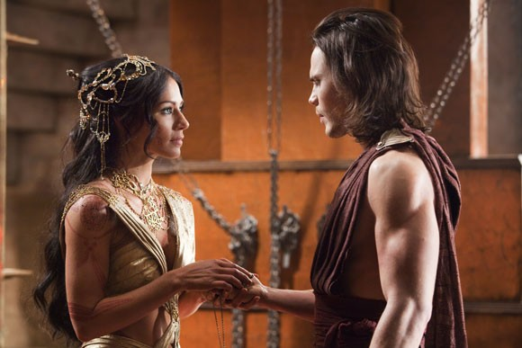 Lynn Collins and Taylor Kitsch John Carter Photo