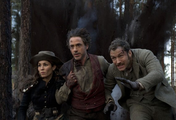 Noomi Rapace, Robert Downey Jr and Jude Law in 'Sherlock Holmes: A Game of Shadows'