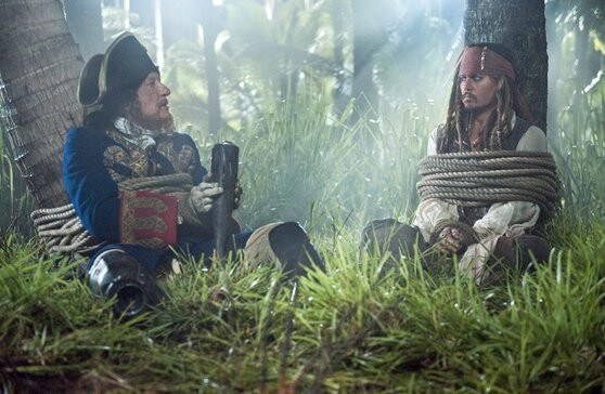 Geoffrey Rush and Johnny Depp in Pirates of the Caribbean: On Stranger Tides