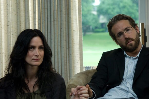 Carrie-Anne Moss and Ryan Reynolds in Fireflies in the Garden