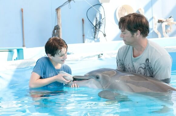 Nathan Gamble and Harry Connick Jr in 'Dolphin Tale'
