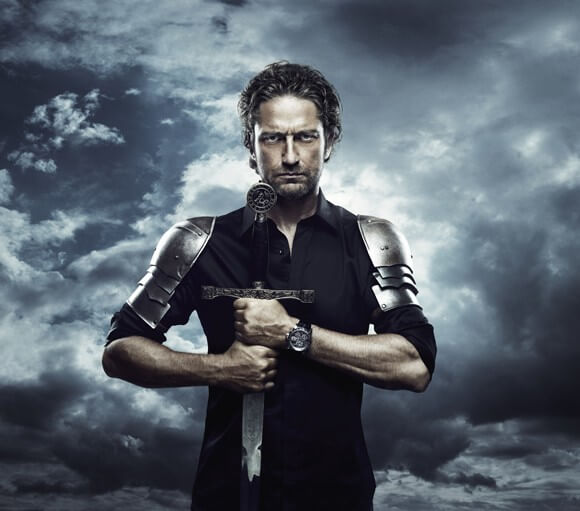 Gerard Butler poses with a Roger Dubuis watch