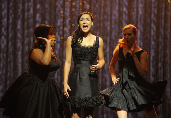 """Mercedes (Amber Riley, L), Santana (Naya Rivera, C) and Brittany (Heather Morris, R) perform the 300th musical performance of GLEE in the """"Mash Off"""" episode"""