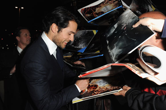 Henry Cavill signs autographs for fans at the Immortals premiere in LA