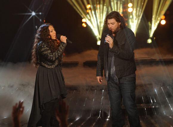 Melanie Amaro (L) and Josh Krajcik (R) perform on The X Factor on Dec. 22, 2011
