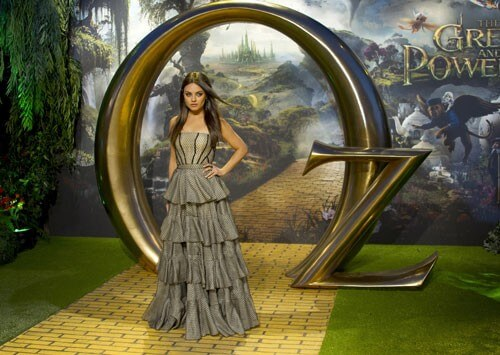 Mila Kunis poses on the Yellow Brick Road at the London Premiere