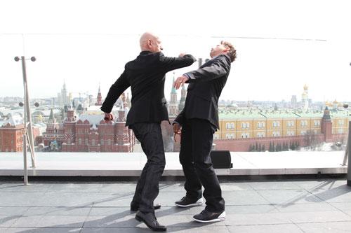 Ben Kingsley aims a punch at Robert Downey Jr