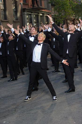 Ellen DeGeneres surrounded by dancers in the Oscar Trailer