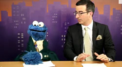 John Oliver and Cookie Monster Broadcast the News