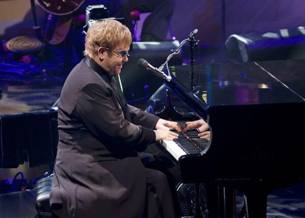 Elton John at piano photo
